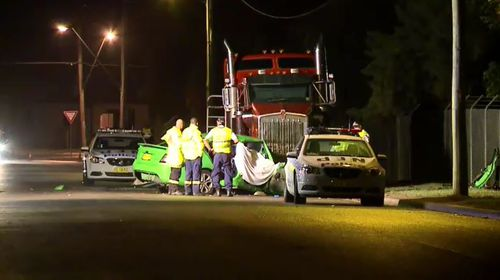 A 42-year-old man died when his car crashed into a parked semi-trailer truck in Emu Plains last night. (9NEWS)