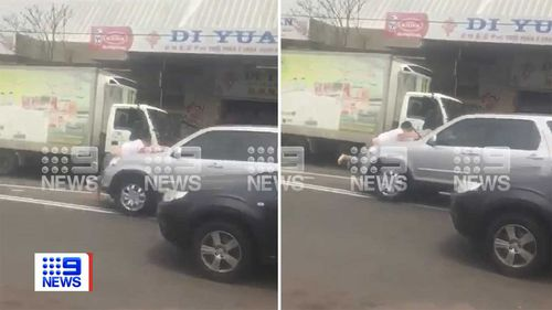 A man is seen clinging to the bonnet of the Honda in Homebush West.