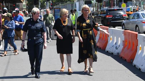 Melbourne Mayor, Sally Capp, Police Minister, Lisa Neville and Assistant Police Commissioner Debra Abbott take a walk over Princes Bridge.