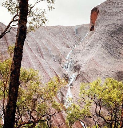 Waterfalls pour off Uluru