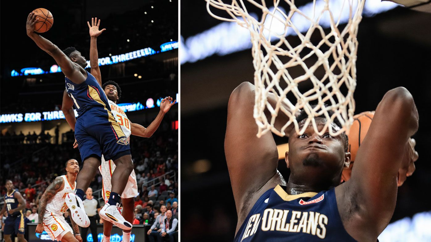 Zion Williamson #1 of the New Orleans Pelicans attempts to dunk over defender Damian Jones #30 of the Atlanta Hawks
