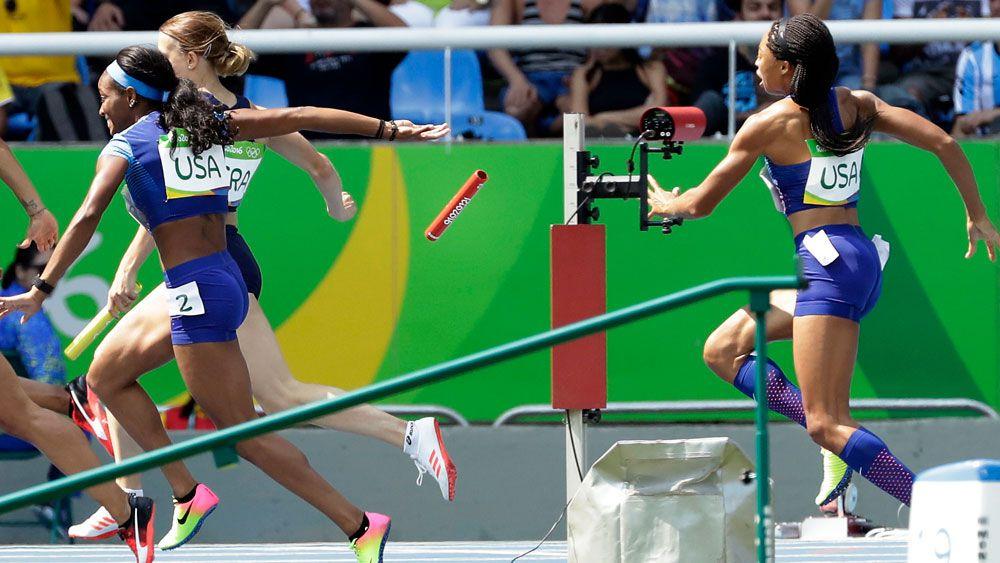 Allyson Felix virtually threw the baton to her teammate. (AFP)