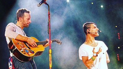 Emmanuel Kelly performs with Chris Martin at Coldplay's Melbourne concert in 2016