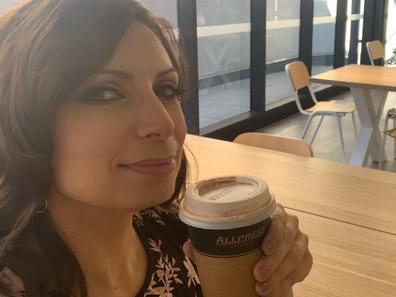Jo Abi with coffee cup takeaway
