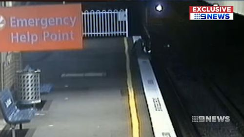 A boy seen dangling his legs over the tracks before a train emerges. Picture: Supplied