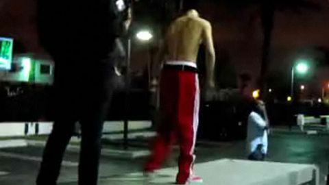 Justin Bieber skateboards shirtless
