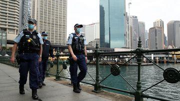 NSW Police patrol Sydney's Circular Quay as the city endures its ninth weekend of lockdown.