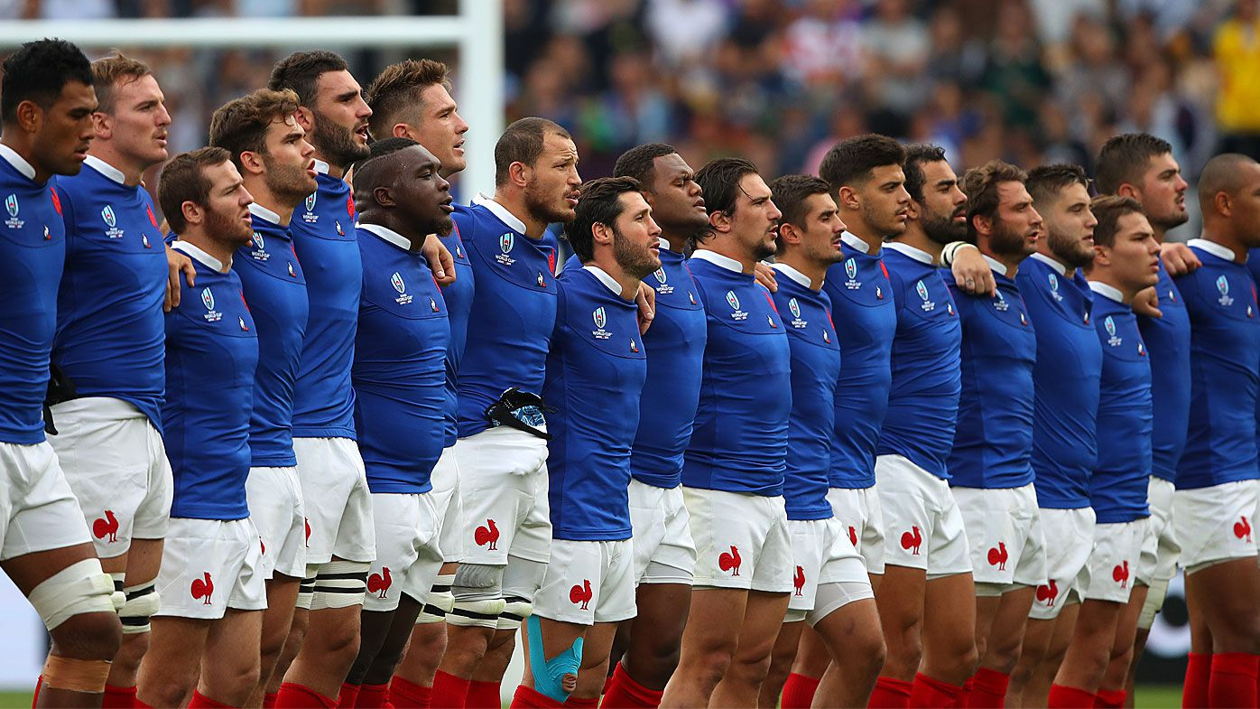 France players line up for the national anthem