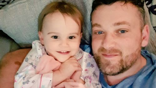 """""""Snuggling with my fave girl #daughter #myworld #twins,"""" he wrote."""