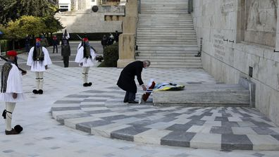Prince Charles lays a wreath at the tomb of the Unknown Soldier in Athens, Thursday, March 25, 2021.