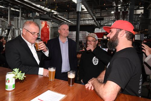 Australian Treasurer Scott Morrison (left) and Australian Finance Minister Mathias Cormann toast with Dan Watters of Capital Brewery and Andy Orrell from Hairyman Brewery during a visit to Capital Brewing Co in Canberra. Picture: AAP