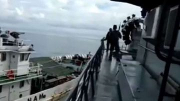 The Indonesian navy said the Vietnamese coast guard (L) tried to prevent the apprehension of an illegal fishing boat by ramming its vessel
