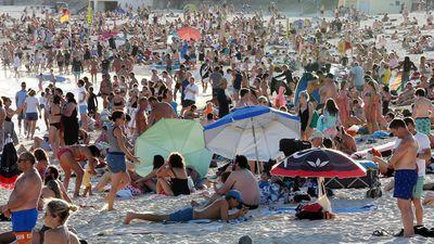 Beachgoers are seen at Bondi Beach