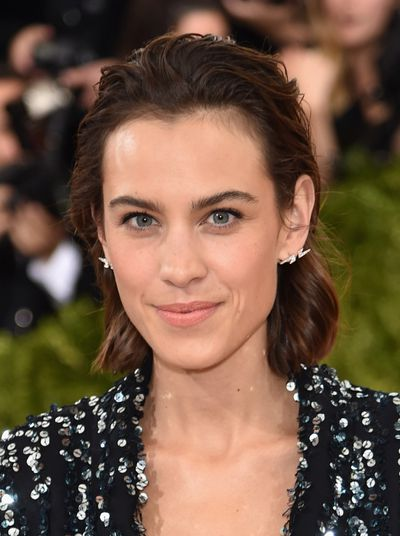 Alexa Chung's fresh-faced look matches the glistening iridescence of her dress - the slicked-back hair is different for her too.