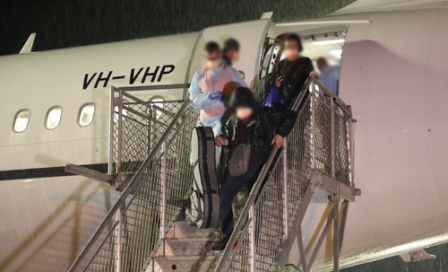 Passengers disembarking the plane at Christmas Island.