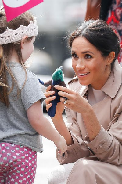 Meghan chats with a young girl in Auckland, New Zealand.