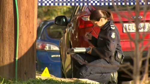A masked man confronted two men about to get in their car - he fired at them and stole a bag one was carrying. Police say it is a targeted attack. Picture: 9NEWS
