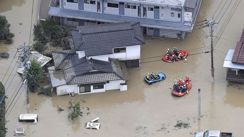 Rescue operation is conducted in a flooded area in Hitoyoshi, Kumamoto prefecture, southern Japan Saturday, July 4, 2020.