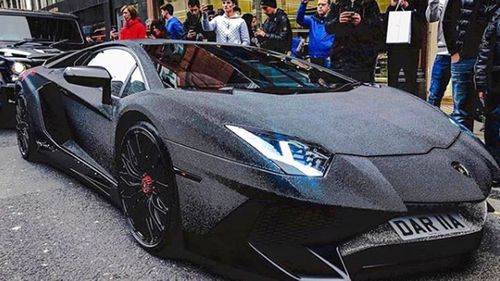 London bystanders stop to snap a picture of the crystal covered Lamborghini Aventador.