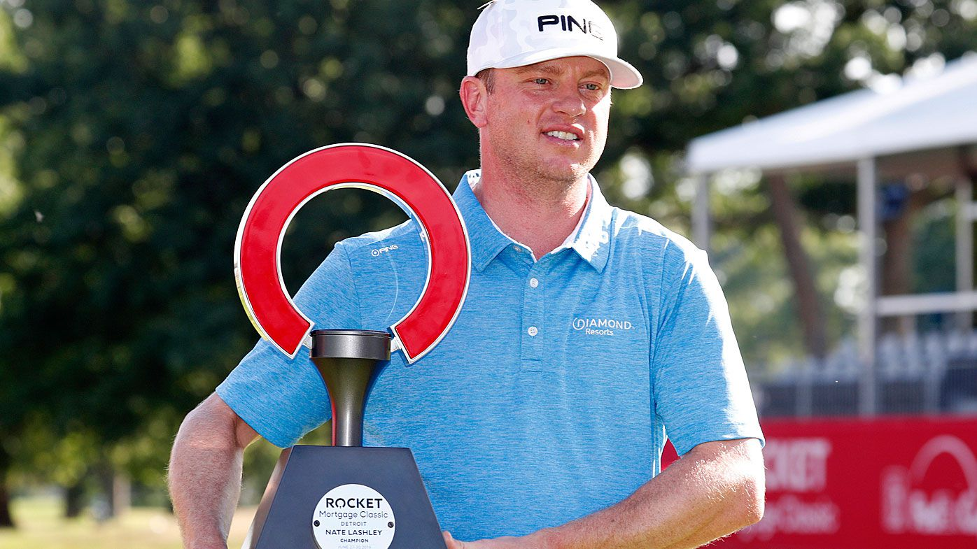 Nate Lashley poses with the trophy after winning the Rocket Mortgage Classic