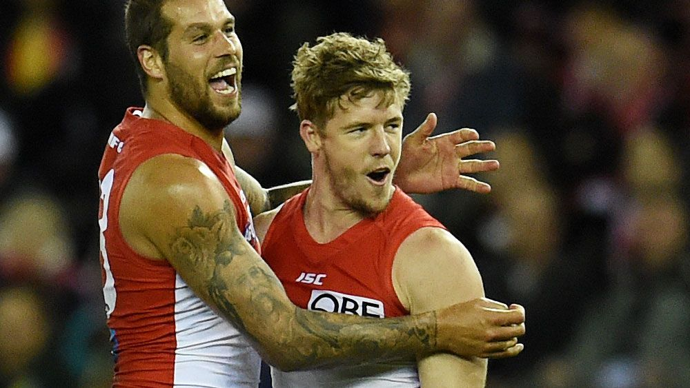 Lance Franklin and Luke Parker in action. (AAP)