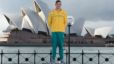 Swimmer Kyle Chalmers shows off a competition and village uniform.