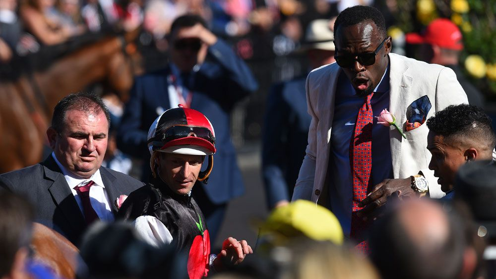 Usain Bolt nearly kicked by horse at Flemington