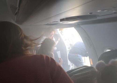 Passengers prepare to leave the plane at Valencia Airport using an emergency slide. Image courtesy Lucy Brown, Twitter.