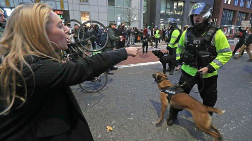 """People square off against police officers during a """"Kill the Bill"""" march in Bristol."""