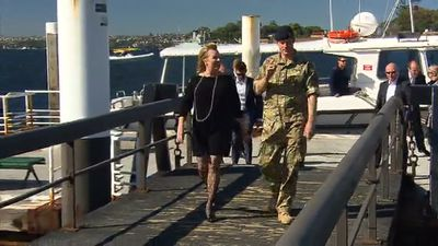 Harry steps from a boat in Sydney Harbour. (9NEWS)
