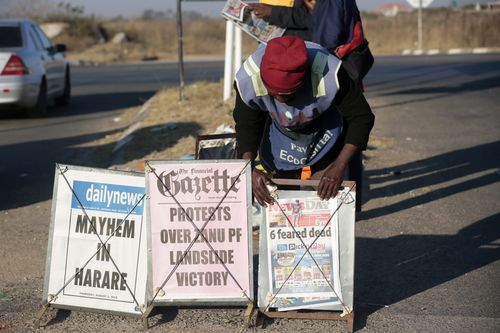 A newspaper vendor offers daily newspapers with headlines regarding the protests in Harare, Zimbabwe, 02 August 2018 on the day after violent protests in the Zimbabwean capital. Media reports say that at least three people were killed during protests after Zimbabwe National Army soldiers fired live bullets at protestors whom were believed to be supporters of the MDC. Oppositional MDC leader Nelson Chamisa was quoted as having called the 30 July election rigged. Zimbabwe held its first post-Mugabe era elections for president, parliament and local councils on 30 July. EPA/AARON UFUMELI