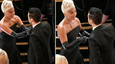 Gaga fixing up Rami Malek's tie at the 2019 oscars