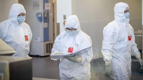 MELBOURNE, AUSTRALIA - NOVEMBER 08: Staff at CSL are seen working in the lab on November 08, 2020 in Melbourne, Australia. CSL will begin manufacturing AstraZeneca-Oxford University COVID-19 vaccine from Monday. (Photo by Darrian Traynor/Getty Images)