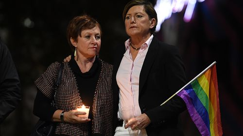 Christine Forster (right), the sister of former prime minister Tony Abbott, with her partner Virginia Edwards. (AAP)