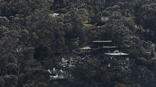The fires destroyed 116 homes. (9News)