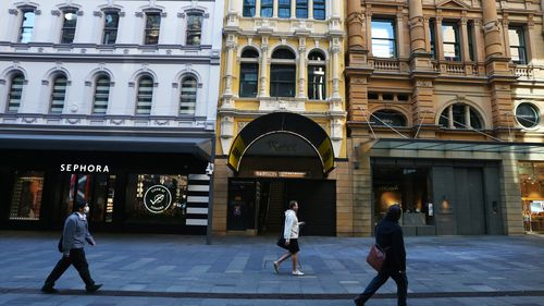 Pedestrians in a very quiet and closed Pitt Street shopping mall in Sydney.