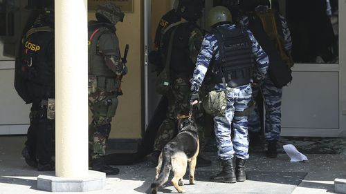 KAZAN, RUSSIA  MAY 11, 2021: FSB and special rapid response unit officers with a service dog enter school No 175 where two attackers opened fire; at least one teacher and eight students are reported dead. Yegor Aleyev/TASS (Photo by Yegor AleyevTASS via Getty Images)