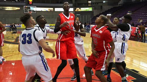 Thon towers over the rest of the players in the paint. Orangeville Prep. (Getty)