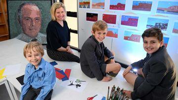 Sydney Grammar Edgecliff Preparatory School students (L-R) Thomas Mansour, 5, Matthew Scolyer, 11, and Savvas Kritharides, 11, pose for a photograph with teacher Janna Tess. (AAP)