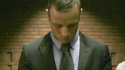 April 7-15: Pistorius takes the witness stand and begins with a tearful apology to the family of the woman he shot dead.  This is followed by five days of hell for the accused, including intense cross-examination by prosecutor Gerrie Nel, marked by several bouts of tears and breaks in the session.  But while he admits to having fired the shots, he refuses to admit any intention to kill his girlfriend. (Getty)