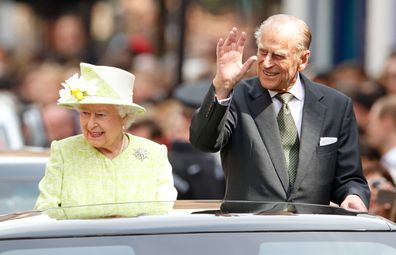 Queen Elizabeth II and Prince Philip, Duke of Edinburgh travel through Windsor in an open top Range Rover after her 90th Birthday Walkabout on April 21, 2016 in Windsor, England.