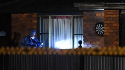Police forensic investigators surround the house in Biddeston. (AAP)