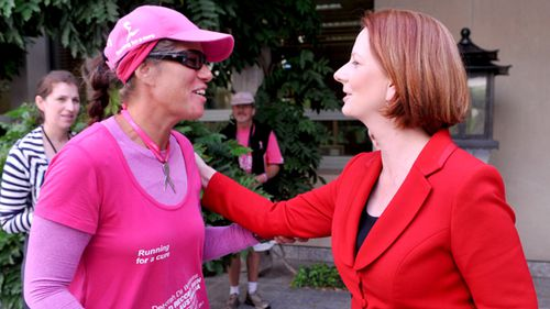 Deborah De Williams (left) meets then Prime Minister Julia Gillard at Parliament House in Canberra in 2011. Deborah was attempting a record breaking run around Australia to raise money for breast cancer research. (AAP)