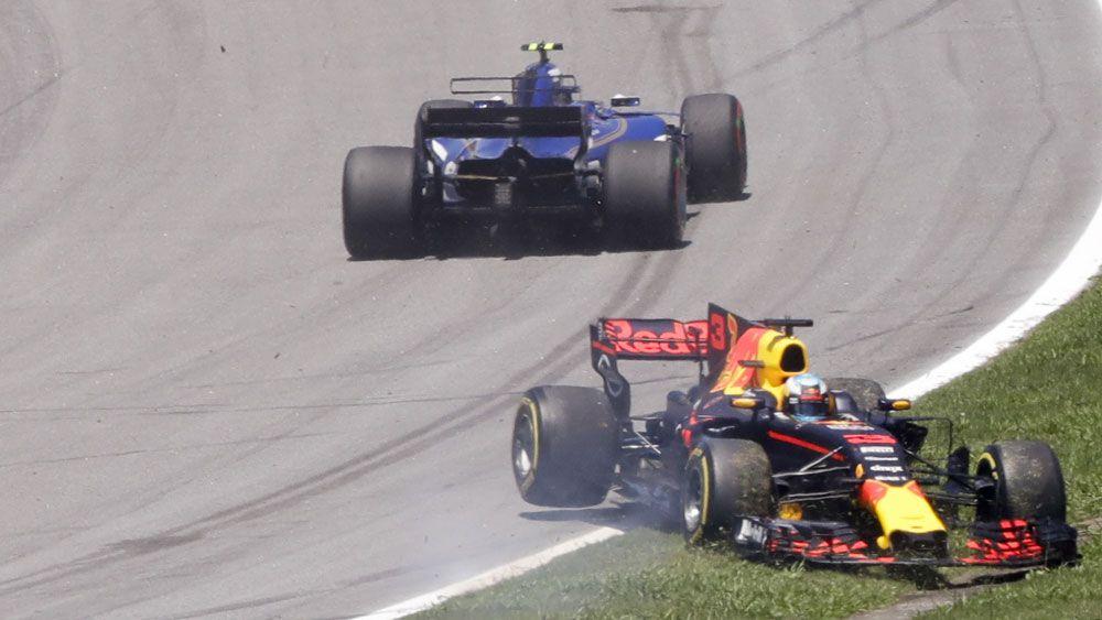 Sebastian Vettel wins Brazilian Grand Prix while Daniel Ricciardo overcomes first lap spin out to finish sixth