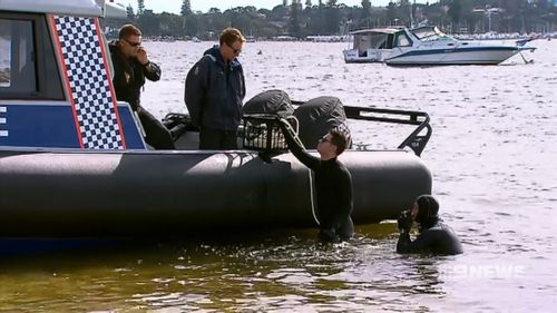 Divers searched for the mother's body in the Swan River.