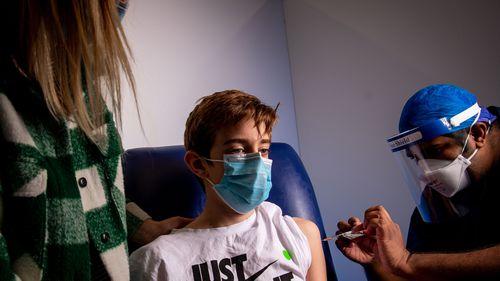Lucas Walsh gets a jab at Heidelberg Repatriation hospital, Victoria.