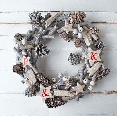 """<a href=""""https://www.hardtofind.com.au/155155_personalised-family-white-christmas-wreath"""" target=""""_blank"""">Solesmith Personalised Family Christmas Wreath, $60.</a>"""