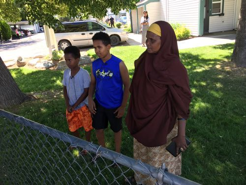 Fathi Mahamoud (left), 11, Esrom Habte, 12, and Thado Aip describe the attack that left nine fellow residents of their Boise, Idaho, apartment complex with stabbing injuries. Picture: AP