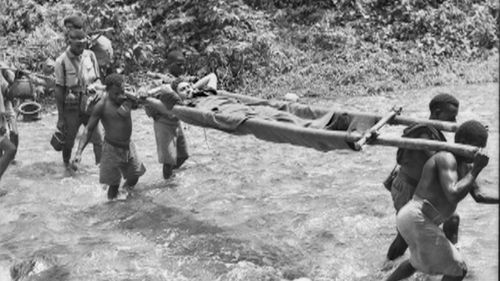 """Papuan porters, known as """"fuzzy wuzzy angels"""" carried Australian soldiers from the frontline."""