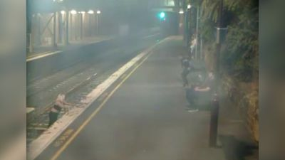 Woman hauled from train seconds with seconds to spare